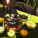 The fondue with sauces, salad and leaves vine