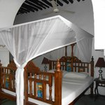 Clean rooms, comfortable beds with mosquito netting - Capaccino