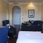 Room with sofa, multiple closet areas