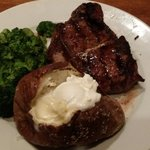 Delmonico with baked potato and steamed broccoli