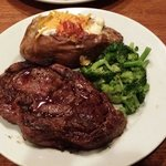 Texas ribeye with loaded baked potato and steamed broccoli