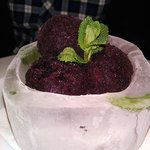 Blueberry sorbet in ice bowel