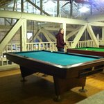 Pool tables in loft of barn
