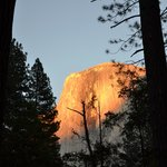 Spectacular view of Half Dome at sunset behind campsite