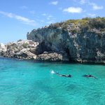 Friends snorkelling in the Thunder ball Grotto in the Exuma Cays