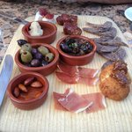 Tasting platter with 7 options  including cheese, sausage, olives and escargots.