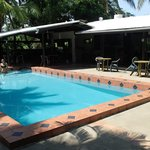 Poolside.  Bar located to the left, kitchen/dining located to the right.