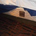 Dangerous steel bar exposed under bed skirt