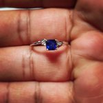 Royal blue sapphire with diamonds set in white gold