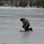 Ice fisherman tries his luck