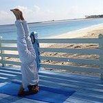 headstand at the beach platform