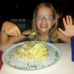 Our daughter enjoying moreton bay bug risotto after waiting for 2 years for it for her birthday