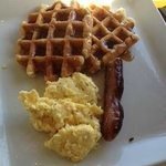 Waffles, eggs and sausage.