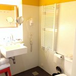 Spacious bathroom with towel warming rack