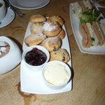 Hot scones with strawberry jam and clotted cream