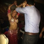 My hubby dancing with the belly dancer!