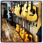 small selection of guitars at Wild Heart Music and cafe