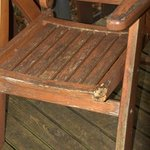 A half-chewed and dirty patio chair