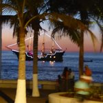 View of pirate ship sailing by