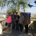 Family photo on top of the memorial with Aravali Mountain view