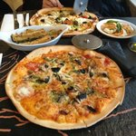 Delicious wood fired pizzas, zucchini fries and buffalo mozzarella salad at Cafe Sia