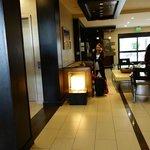 lobby area, restaurant behind lady