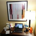 room artwork above desk