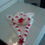 Towel and flower designs left by housekeeping