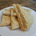 Mountain of garlic bread minus a slice
