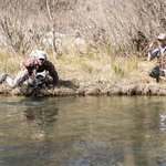 Guide Ivan Tarin helping to land a big zebra trout