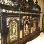 Detail of bed headboard in the Venetian Room