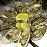 Crossings - Oysters on the Half Shell - mango mignonette, lemon, horseradish by Executive Chef L