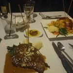 Table setting and main entree: Gorgonzola rib eye and Lobster pasta in vodka sauce!