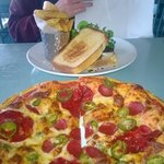 Pizza and an open toasted sandwich with chips!