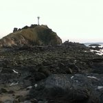 The lighthouse from the rocky beach