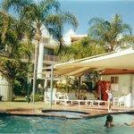 Pool and palms at Sanctuary Beach Resort