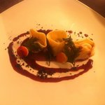 Venison tortellini with shallot ash and beetroot jus