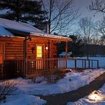 Log cabin cottages at dusk in the winter
