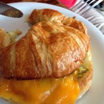 Breakfast croissant with veggies and eggs
