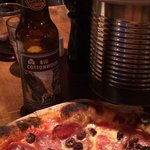 Our pizza and a Squatters Big Cottonwood Amber Ale.