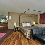 "King Suite - Jacuzzi, 50"" TV, Wood Flooring, Refrigerator and Microwave."