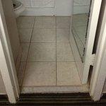 Very narrow entry. Notice toilet seat size to toilet bowl.