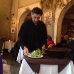 Antoni prepares a delicious, table side Caesar salad