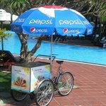 Stop me and buy one Ice cream cycle which goes around pools area at 1100