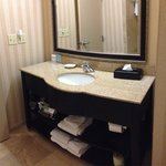 Beautiful updated bathroom. Extra Amenities: hair dryer, coffee/coffee maker, lotions and shampo