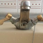 Very dated taps in bathroom