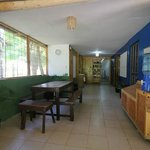 The hostel features several areas for dining and relaxing