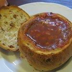 Goulash baked in a globe of bread