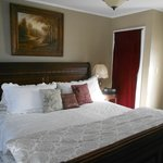Beautiful King Room 11 with dark Sleigh bed