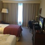Twin bed with TV and a nice view looking into the city